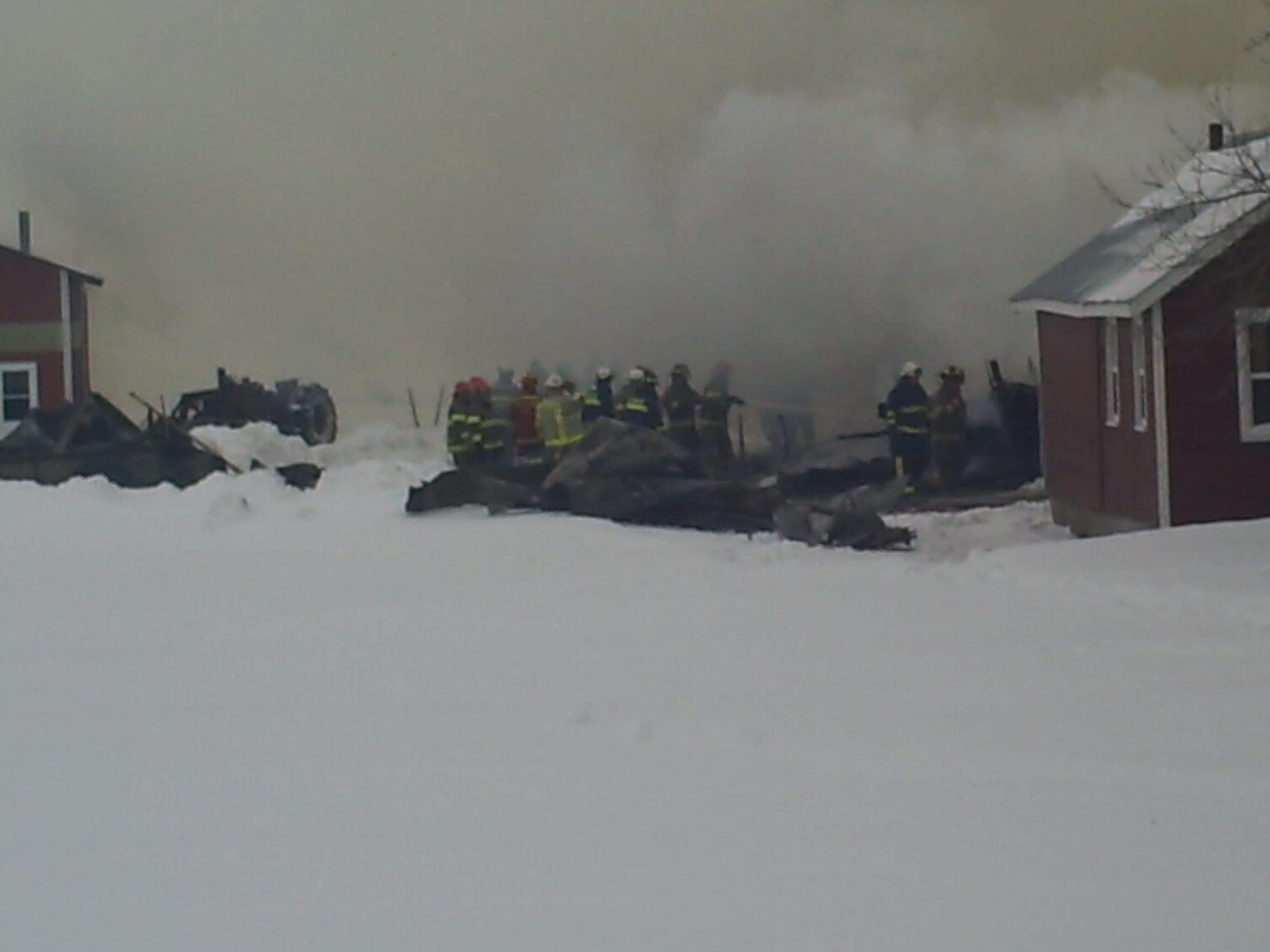 Fire Fighters wetting down the barn