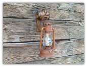 A A Hub and Horseshoe Rustic Wall Sconce