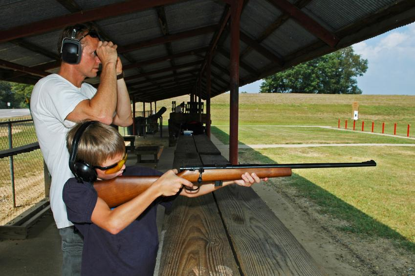 Father target shooting sabot reloaded ammo with son.