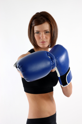Female Kickboxer with cardio gloves